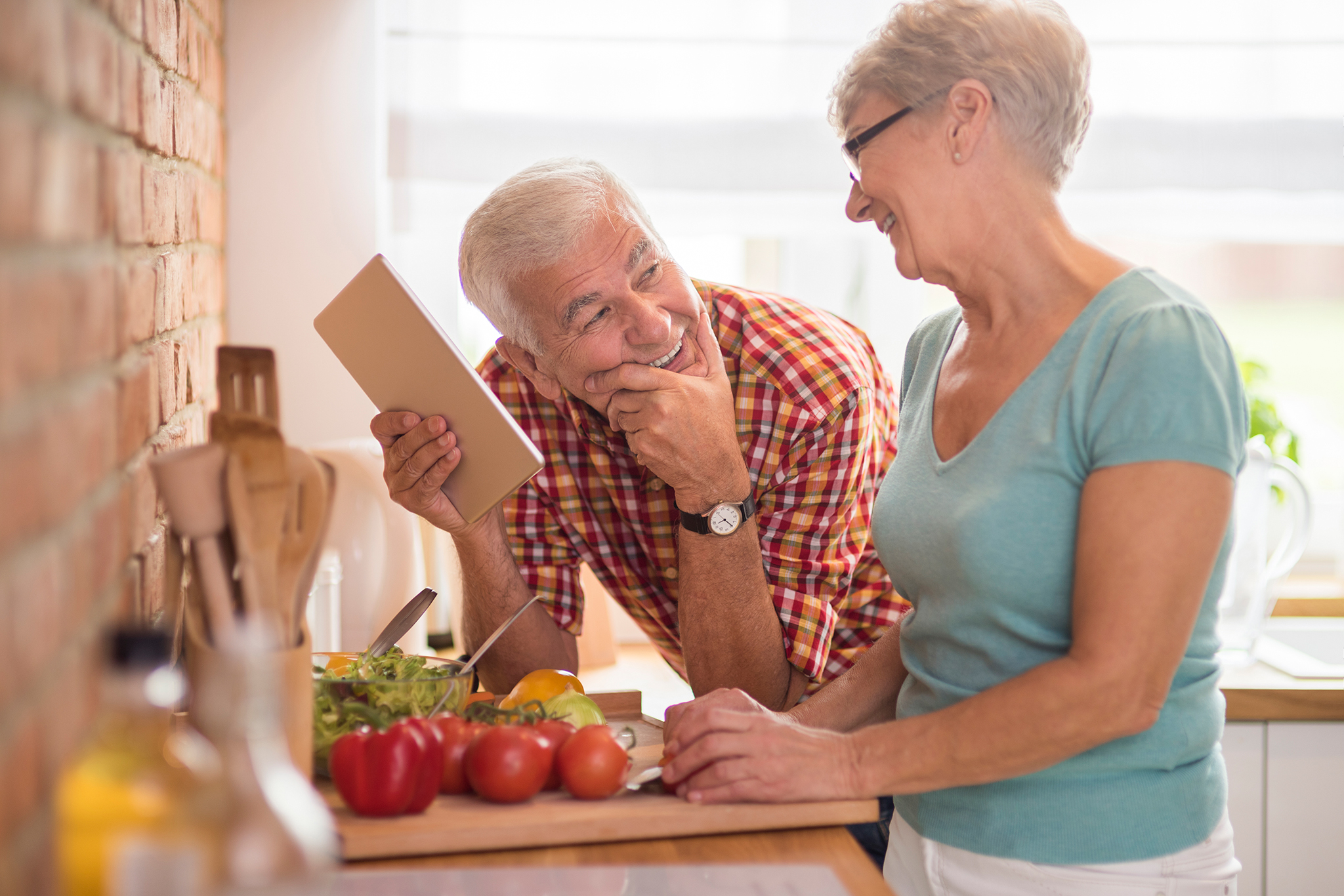 Senior couple in kitchen naturopathic patient